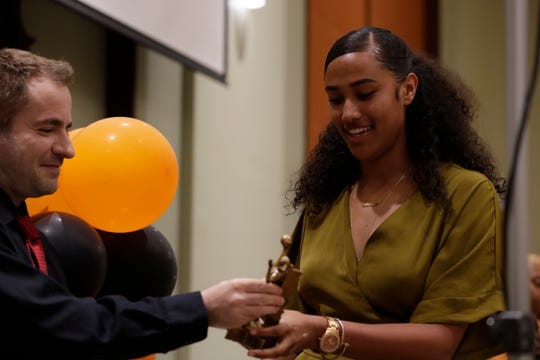FAMU volleyball outside hitter Alexis Gosha accepts the Pride Award from head coach Gokhan Yilmaz at the 2019 Fang Awards on Monday, April 22, 2019.