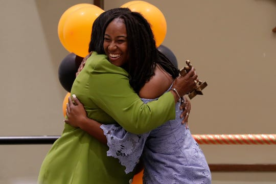 FAMU softball head coach Veronica Wiggins shares a warm hug with infielder Kimiya Watkins after she receives the team Rookie of the Year at the 2019 Fang Awards.