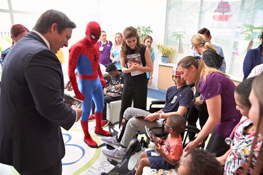 Gov. Ron DeSantis and First Lady Casey DeSantis visit with patients at Joe DiMaggio Children's Hospital in Hollywood.