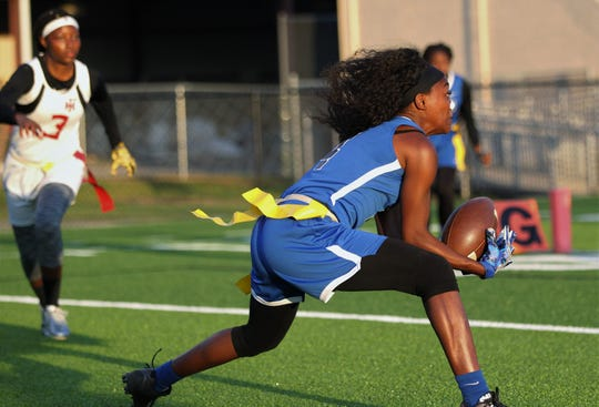 Godby senior Armarni Williams makes a touchdown reception as Godby beat Florida High 22-12 in a flag football district semifinal on April 22, 2019.
