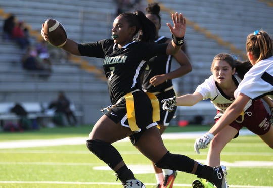 Lincoln quarterback Erin Turral scores on a touchdown run as Lincoln beat Chiles 32-0 during a flag football district semifinal on April 22, 2019.