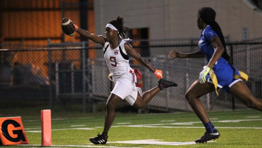 Florida High's Janae Scott scores a 50-yard fumble return touchdown as Godby beat Florida High 22-12 in a flag football district semifinal on April 22, 2019.