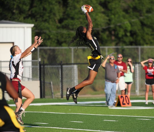 Lincoln senior Kayley Farmer high points an interception as Lincoln beat Chiles 32-0 during a flag football district semifinal on April 22, 2019.