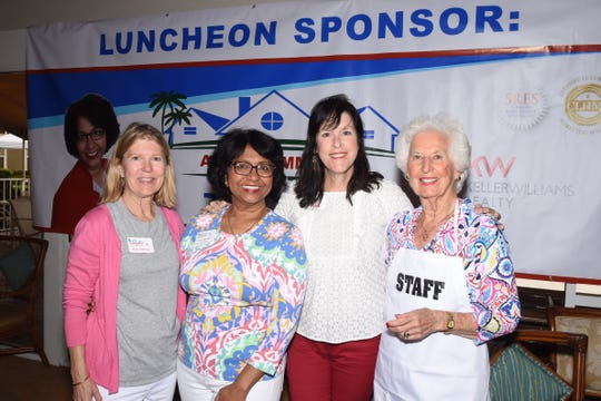Kate Atterbury, left, Arati Hammond, Barbra Clifton and Terri McCall at the Sandhill Cove Art Sale and Show benefiting Helping People Succeed.