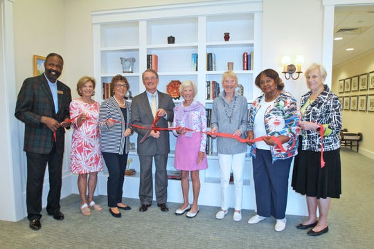 Freddie Woolfork, left, Lisa Holmes, Liz Melnick, Scott Alexander, Deborah Leeming, Sue Joyce, Mary McKinney and Trudie Rainone are ready for the ribbon cutting ceremony at 4:30 p.m. May 15 at the newly expanded Gifford Youth Achievement Center, 4875 43rd Ave.