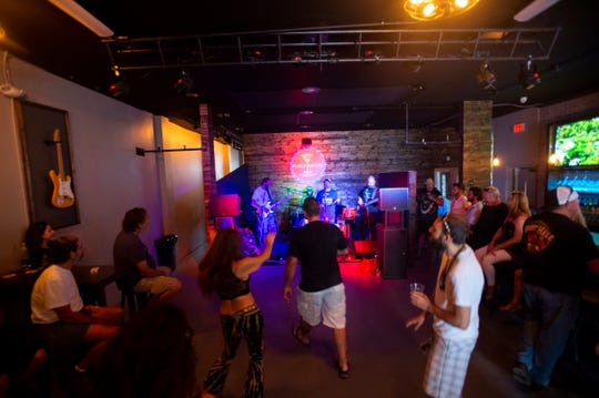 Miami-based band JUke performs on Bottom's Up Public House opening day party Saturday, April 20, 2019, at the bar in Fort Pierce. The new music venue and bar, located at 208 Avenue A, unit B, will work with local event promotor Cosmic Barley to host live music and recurring events, like vinyl night on Tuesdays and open mic night on Thursdays.