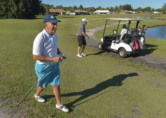 "Dennis Sampson (from left) walks back to his cart from the 4th tee of the Vista Royale red course while playing in a men's league with his friends Stuart Houck, Russ Geiger, and Barry Smith (not pictured), on Monday, April 22, 2019, at the Vista Royale in Indian River County. Dennis, and his wife Luann Sampson are trying to purchase the three nine-hole golf courses in the Vista Royale community where they reside. ""Last April, when this course was shut down, we decided we had to do something,"" Sampson said. ""So then we set up a corporation, we're rallying the community members together to buy the golf course and manage it, and save our community property value."" The red course has since reopened."