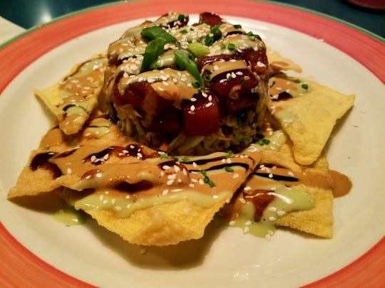 The tuna nacho appetizer was brimming with a multitude of flavors.