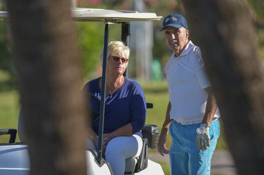 "Dennis Sampson stops to talk to his wife Luann Sampson as his friends tee off from the second hole of the red course on Monday, April 22, 2019, at Vista Royale in Indian River County. The couple are trying to purchase the three 9-hole golf courses in the Vista Royale community where they live. ""We're selling golf packages, there's three different golf packages,"" Luann Sampson said. ""We want people to come alongside and buy in so they can rehab the golf course."""