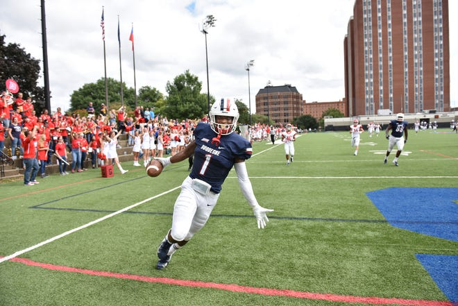 Former Fort Pierce Central wide receiver Nehari Crawford celebrates scoring a touchdown for Duquesne in 2018.