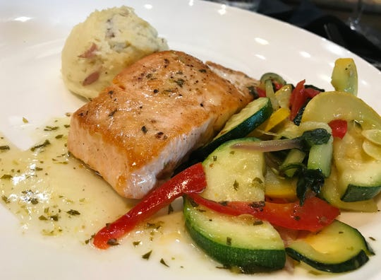 Taplow Pub's salmon was perfectly pan seared and topped with a silky, lemony sauce.