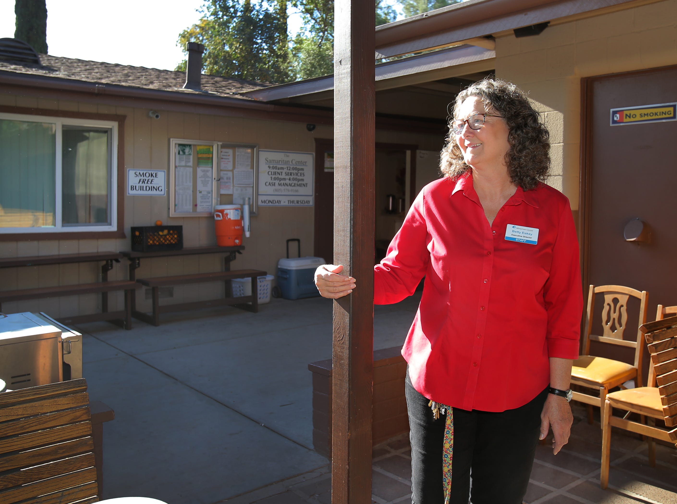 Samaritan Center Executive Director Betty Eskey stands near the entrance of the Simi Valley homeless shelter. After 13 years there, Eskey will be retiring in July on advice of doctors.