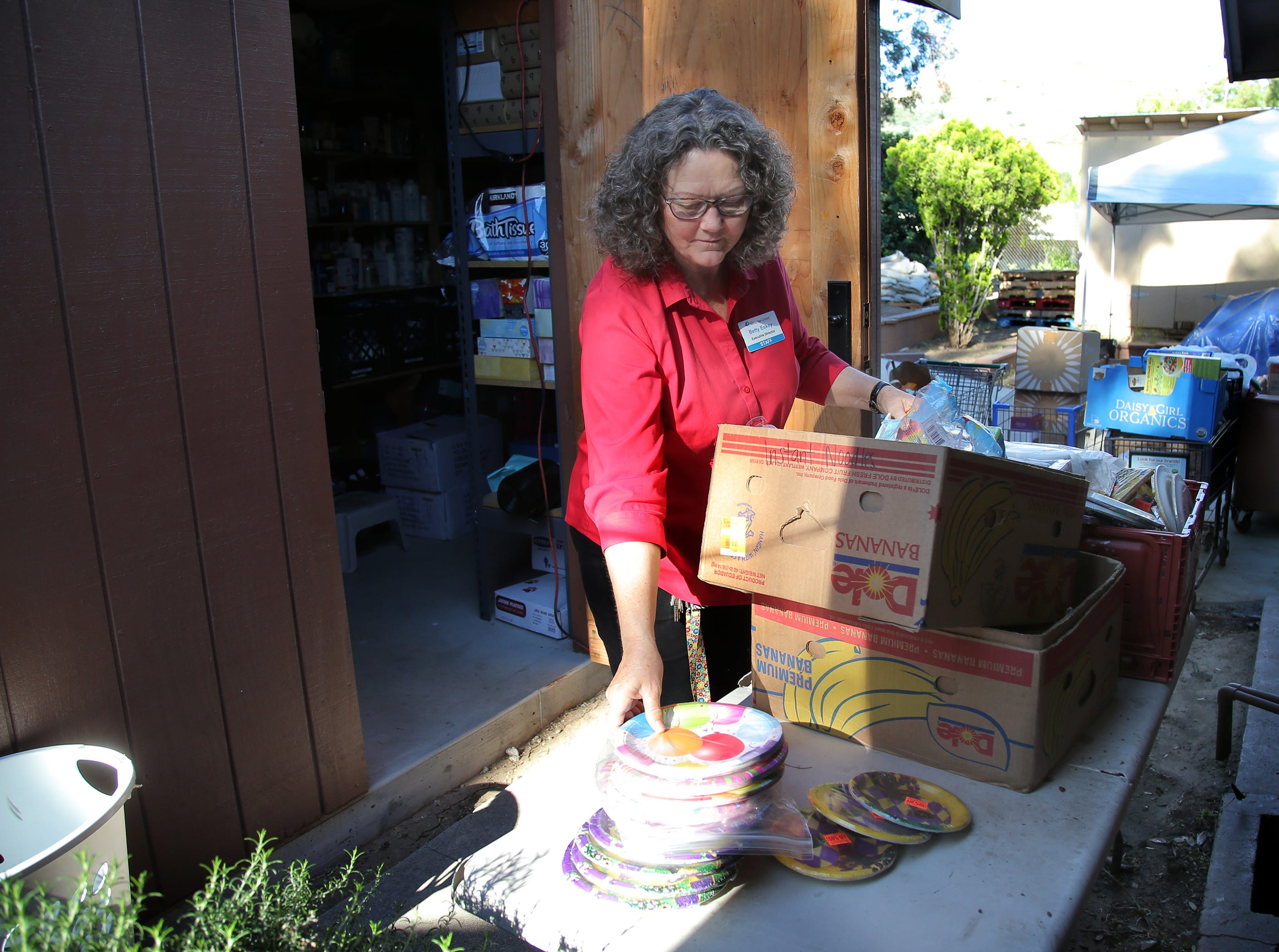 Samaritan Center Executive Director Betty Eskey goes through some donations that the nonprofit Simi Valley homeless shelter receives.