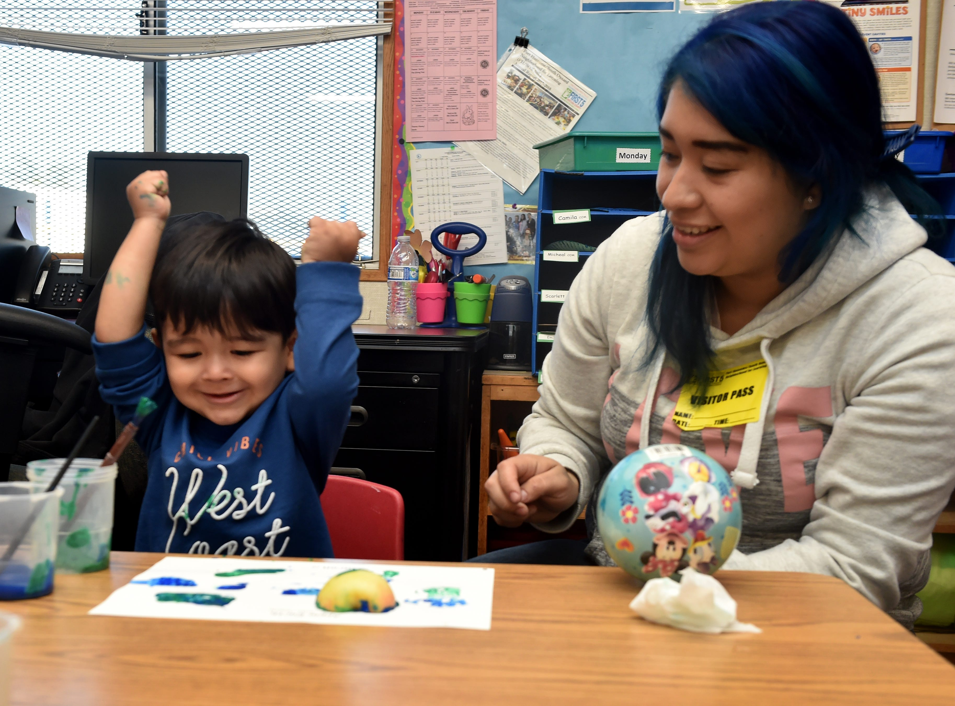 Aaron Juarez, age 2, paints with his mother, April Alzivar, during a First 5 Neighborhoods for Learning class at Hathaway Elementary School in Oxnard on April 23.