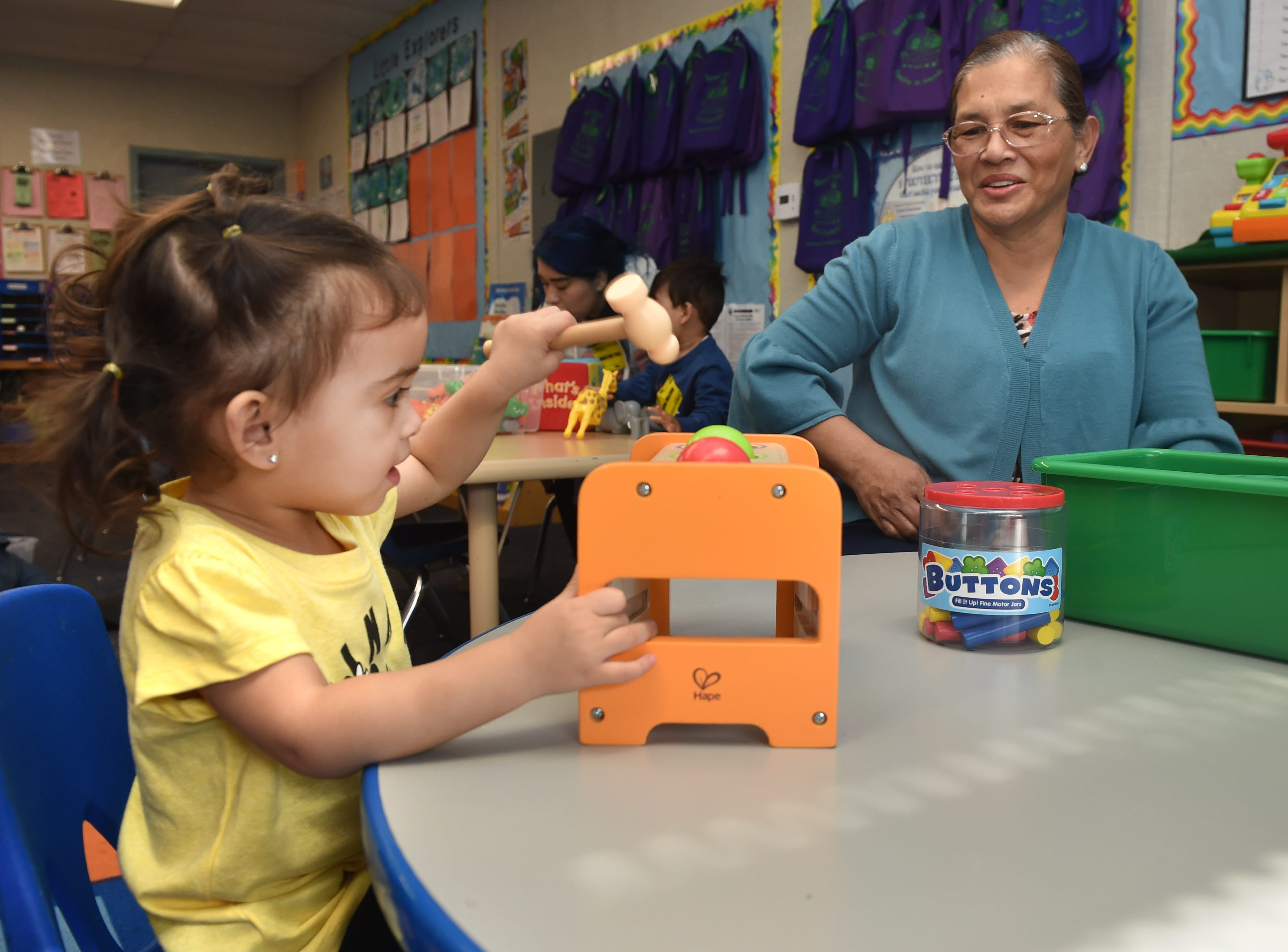 Roxanne Barbittin, age 2, learns her colors while playing with her grandmother Lorena Jandoc during a First 5 Neighborhoods for Learning class at Hathaway Elementary School in Oxnard.