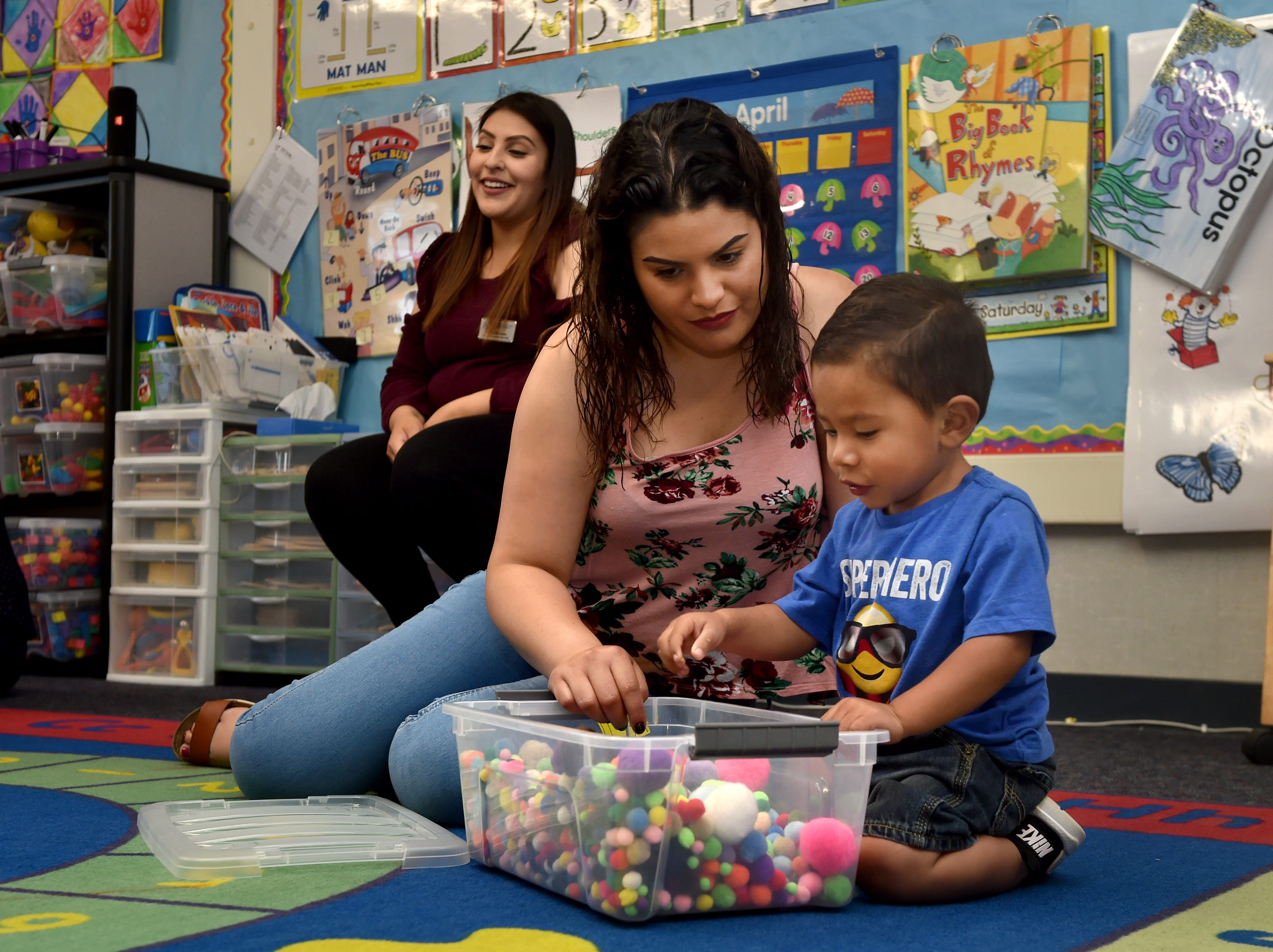 Alondra Lopez and her son Maximilio Sanchez play with colorful balls during a First 5 Neighborhoods for Learning class at Hathaway Elementary School in Oxnard on April 23.