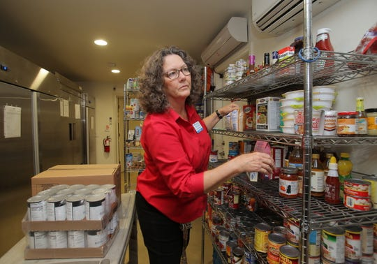 Samaritan Center Executive Director Betty Eskey checks the stock in the Simi Valley homeless shelter's pantry area on Tuesday.  After 13 years at the center, Eskey will be retiring in July on advice of doctors.