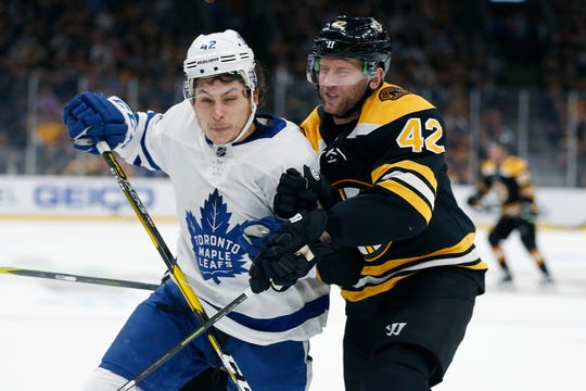 The Maple Leafs' Trevor Moore, left, checks the Bruins' David Backes during the teams' first-round NHL playoff series. Moore, a Thousand Oaks native, had eight points in 26 games in the regular season as a rookie.