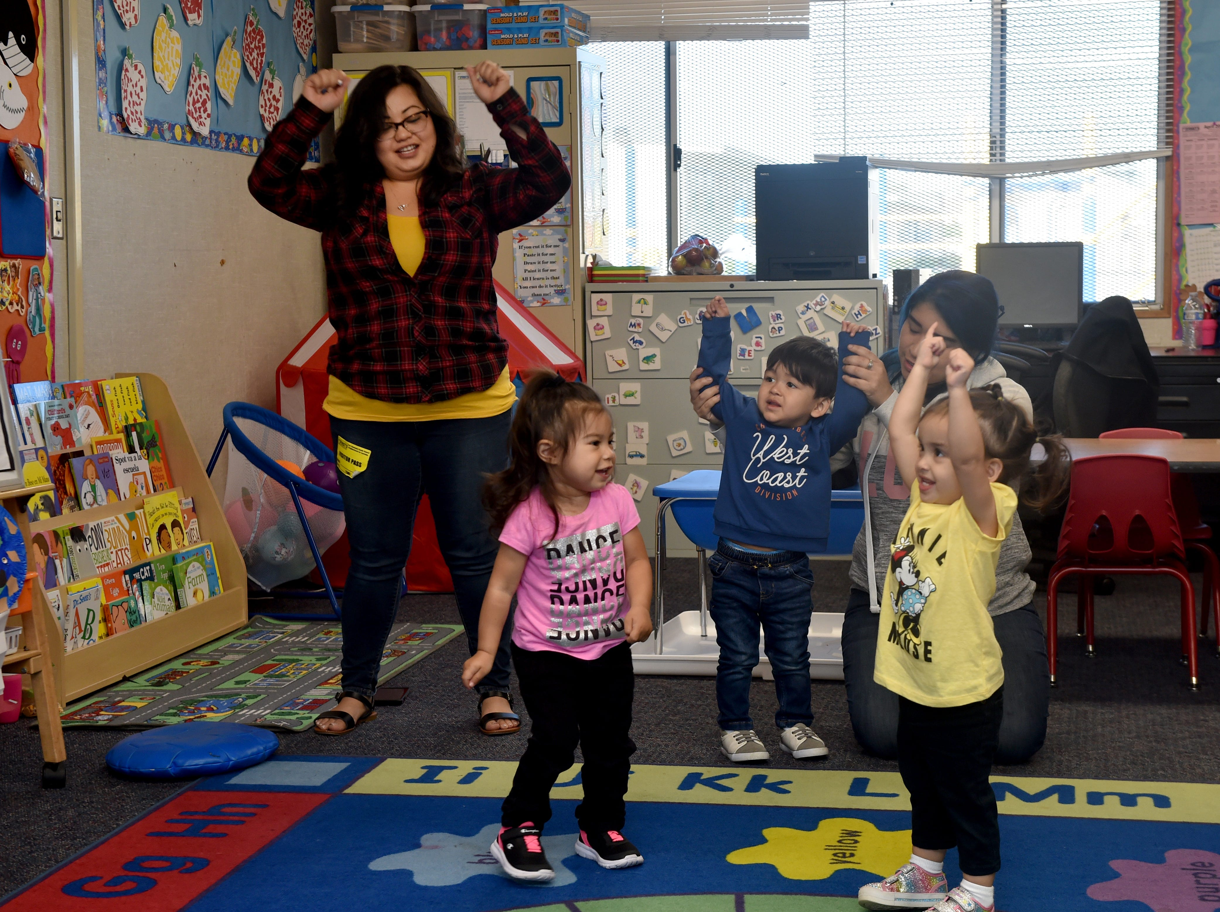 (From right) Roxanne Barbittin, Aaron Juarez and Anya Garcia dance during a First 5 Neighborhoods for Learning class at Hathaway Elementary School in Oxnard on April 23.