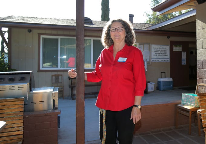 Samaritan Center Executive Director Betty Eskey stands near the entrance of the Simi Valley homeless shelter. After 13 years,  she will be retiring in July.