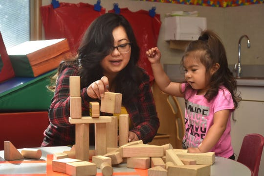 Anya Garcia, age 2, and her mother, Desiree, stack blocks during a First 5 Neighborhoods for Learning class at Hathaway Elementary School in Oxnard on April 23.