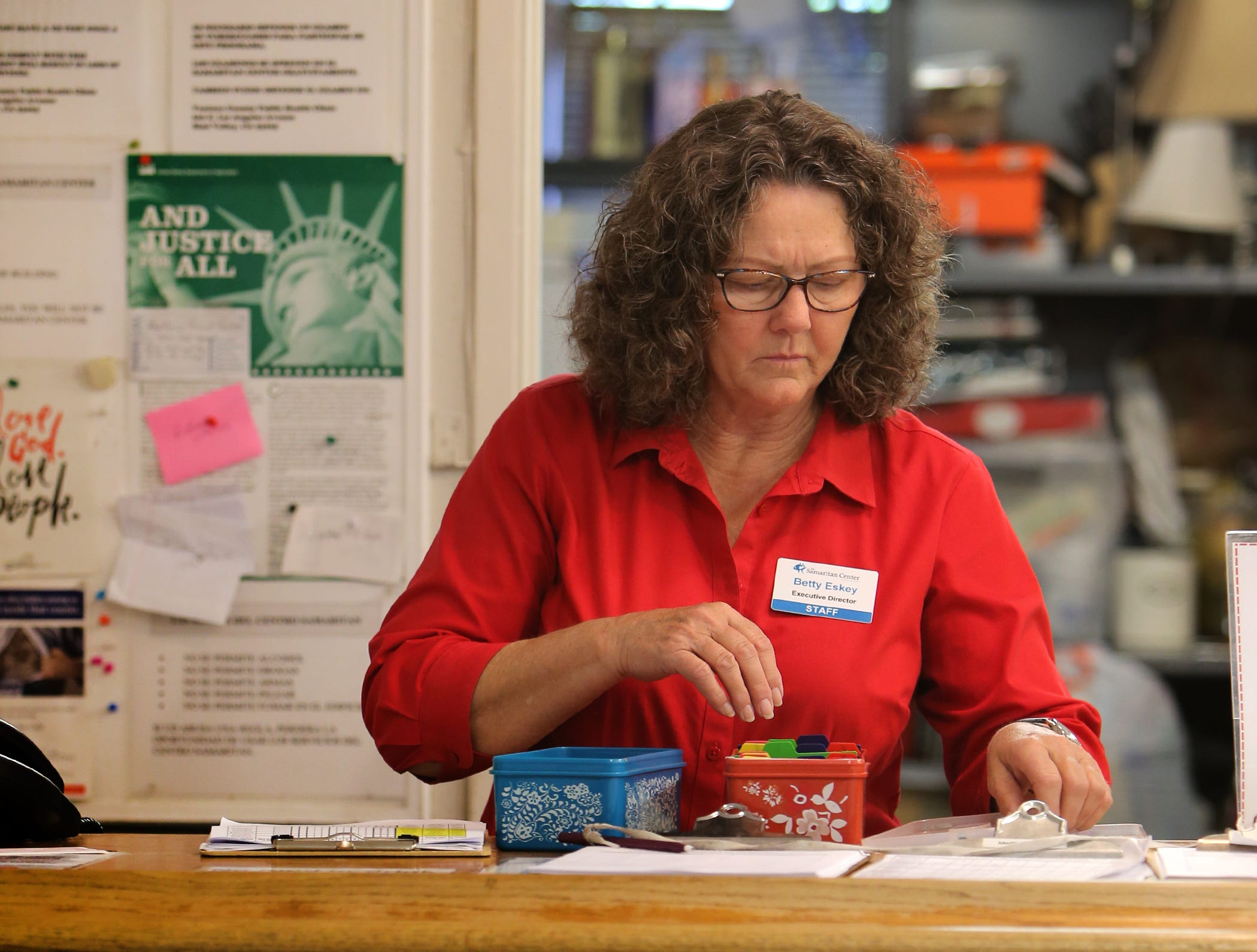 Samaritan Center Executive Director Betty Eskey works at the front desk of the Simi Valley homeless shelter. After 13 years at the center, Eskey will be retiring in July on advice of doctors..