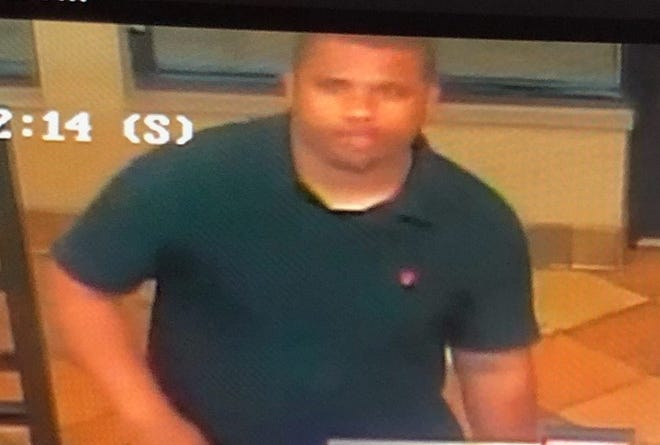 Police want to identify this person in connection with a fraud investigation.