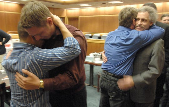 Breanna Schneller's Brother Rocky Schneller, center left, hugs Sebastian Ramirez, far left, while Breanna Schneller's dad Craig Schneller, center right, hugs Marathon County District Attorney Ken Heimerman at the end of the verdict reading at the Raul Ponce-Rocha trial held at Marathon County Courthouse on Jan. 11, 2011.