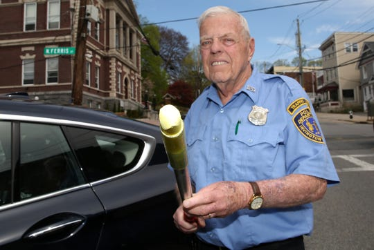 Irvington Parking Enforcement Officer Jimmy Brennan shows the chalk he uses to mark tires on cars along Main Street in Irvington April 23, 2019.