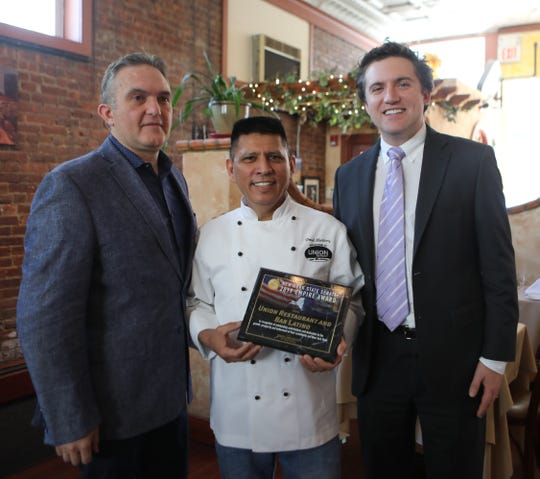 Senator James Skoufis, right, presents the Empire Award to Paulo Feteira, left, and David Martinez, center, of Union Restaurant in Haverstraw April 23, 2019. WeCare Foundation which partners with many local charities to support them through events hosted at Union restaurant.
