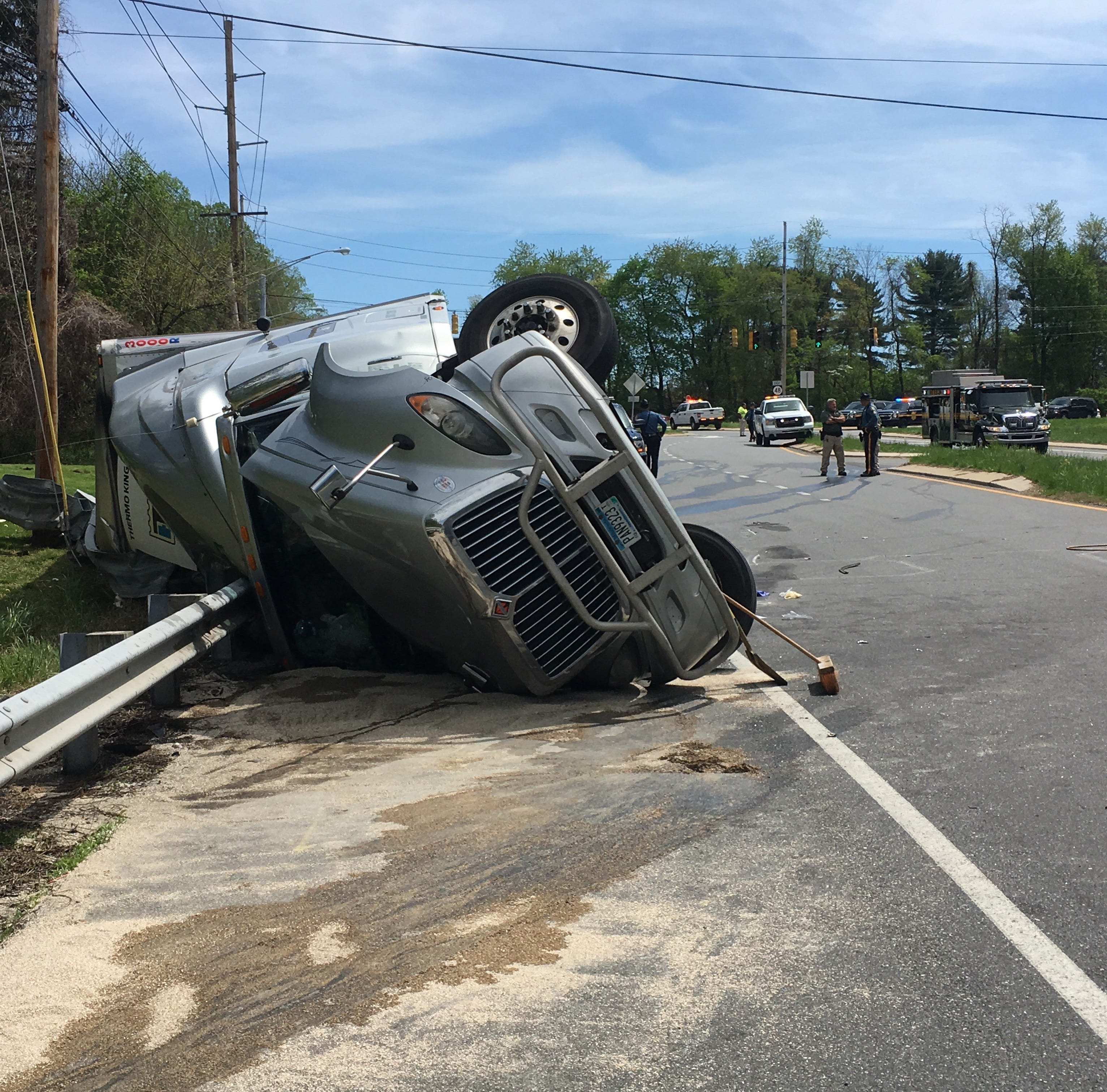 Overturned truck full of pineapples closes Lancaster Pike at Newport Gap Pike, near Hockessin