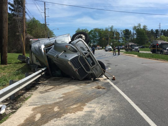 An overturned tractor-trailer closes traffic at Lancaster and Newport Gap pikes, near Hockessin, on Tuesday, April 23, 2019.