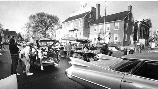 """A film crew works from the back of a car as they shoot a """"Dead Poets Society"""" scene in New Castle in November 1988."""