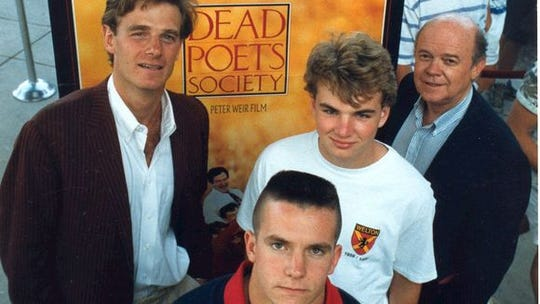 "The scene at the sneak preview of ""Dead Poets Society"" at Christiana Mall on June, 3 1989. Local actor Matt Carey, who plays Hopkins in the film, is in front. Back row from left to right: St. Andrew's teacher Ashton Richards, Sam Stegeman and Hoover Sutton."