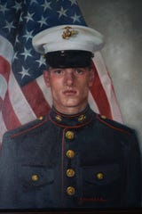 "A painting of 23 year-old Sgt. Boyd ""Chip"" Wicks that hangs in the living room of his parents home."