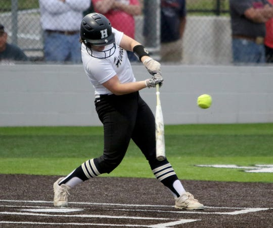 Henrietta's Kylee Erickson hits a triple against Holliday Monday, April 22, 2019, in Iowa Park.