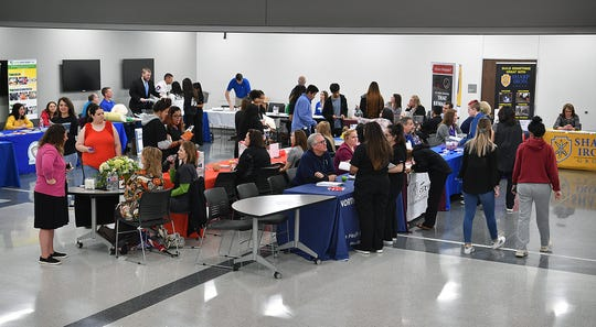 About 30 representatives of companies and colleges were on hand for the first College and Career Fair at the Career Education Center Tuesday. The CEC has 350 graduating seniors this year.
