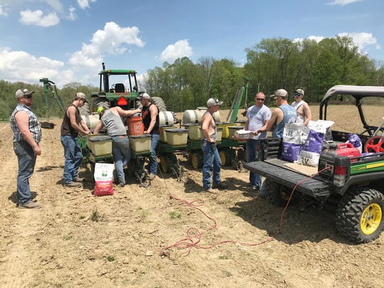 New Lex FFA students prepare to clean out the planter and put in hybrid seeds in a field at the new farm. The FFA will take care of the farm and use it for real-life experience.