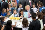 President Trump pledged to a child attending the White House Easter Egg Roll festivities that he would keep up his work on the southern border wall.