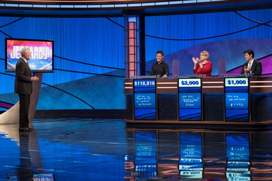 """""""Jeopardy!"""" host Alex Trebek, left, and contestant James Holzhauer during Tuesday's episode."""
