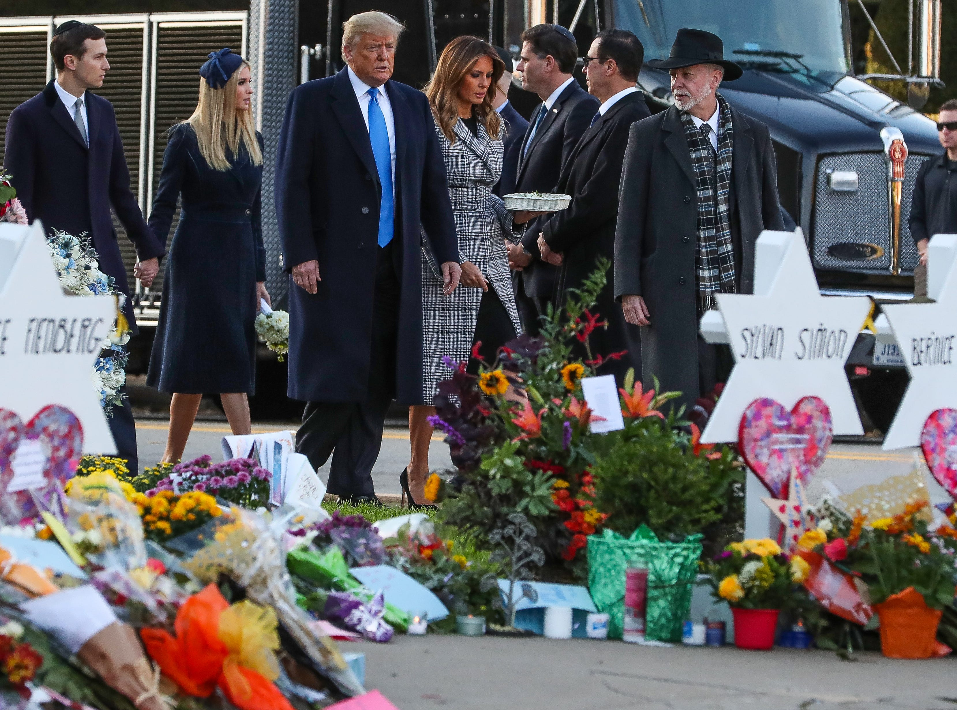 President Donald Trump walks with Melania, Ivanka and son-in-law Jared Kushner, alongside Tree of Life Synagogue rabbi Jeffrey Myers, near the memorial site to the 11 victims in Pittsburgh on Tuesday, Oct. 30, 2018.