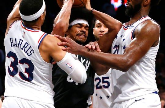 Nets center Jarrett Allen loses the ball against the 76ers.