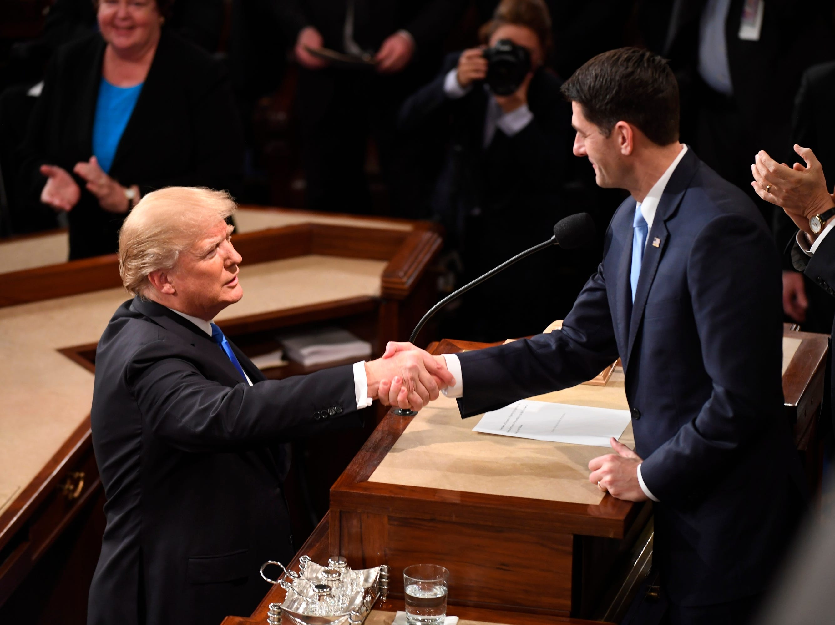 President Donald Trump greets House Speaker Paul Ryan before delivering the State of the Union address on Tuesday, Jan. 30, 2018 from the House chamber of the United States Capitol in Washington.