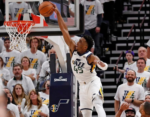 April 22: Jazz guard Donovan Mitchell throws down the one-handed slam during Game 4 against the Rockets.