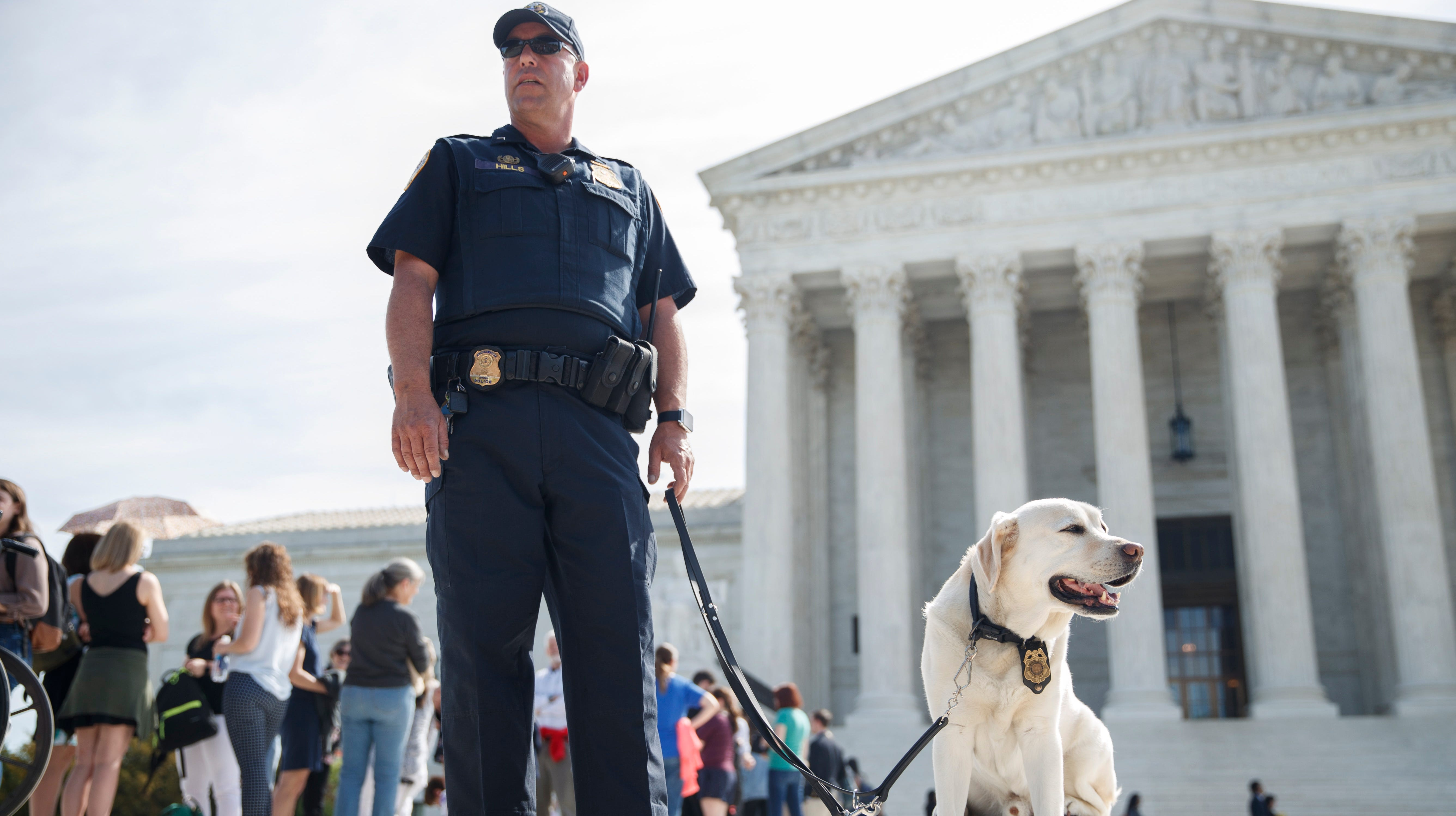 Supreme Court police and canines were on the job Tuesday as the justices heard a case about drawing blood from an unconscious motorist.