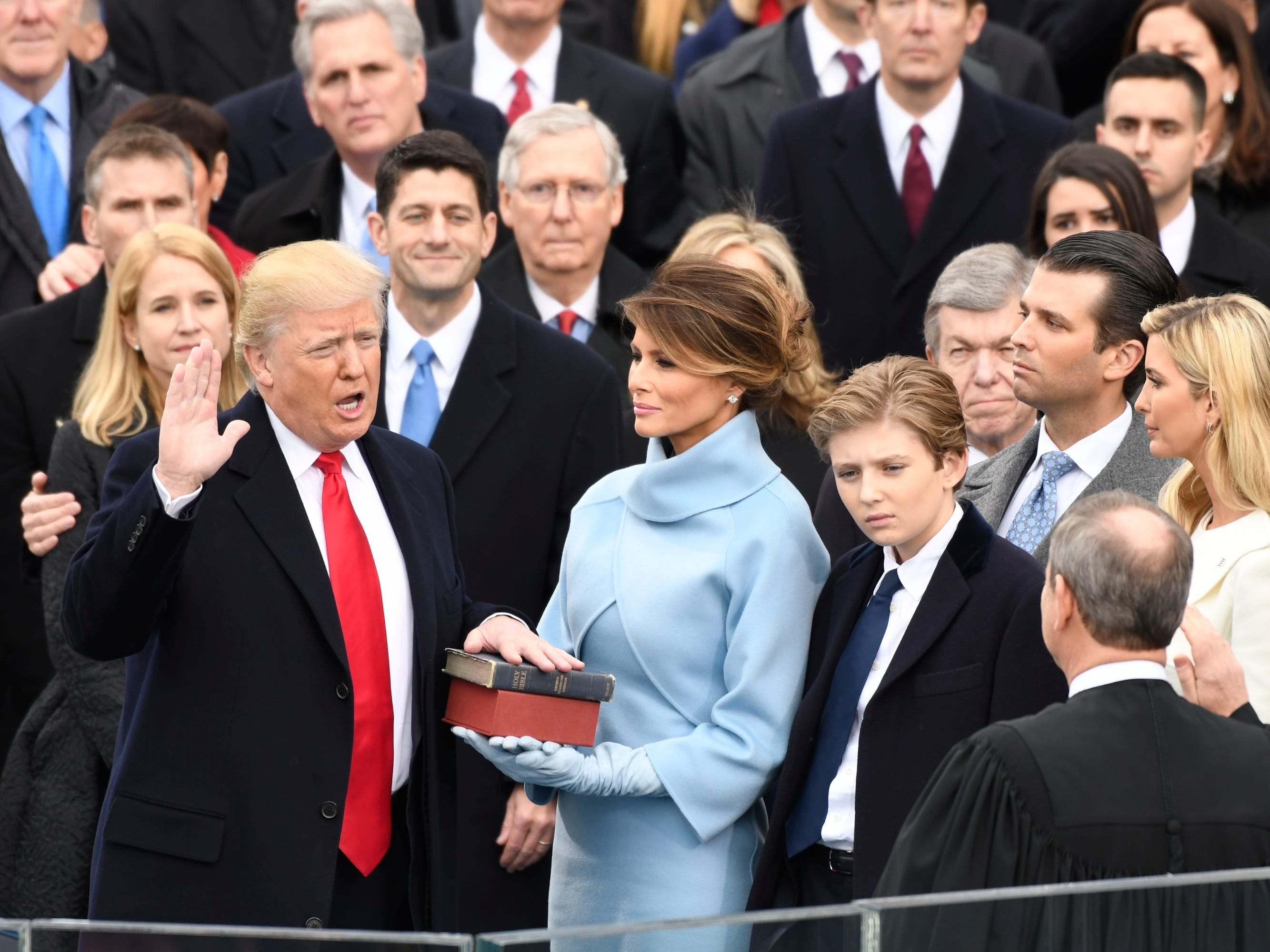 Donald Trump takes the oath of office, while standing with Melania Trump and Barron Trump, during the 2017 Presidential Inauguration at the U.S. Capitol. Chief Justice John Roberts administered the oath of office Jan 20, 2017.