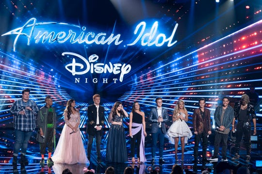 The 'American Idol' Top 10 take the stage with singing star Lea Michele, sixth from left, during Disney Night. Two finalists were eliminated at the end of Sunday's show.