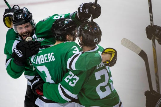 The Dallas Stars celebrate the overtime goal by defenseman John Klingberg.