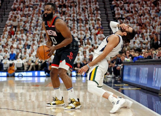 April 22: Jazz guard Ricky Rubio reacts after being fouled by Rockets guard James Harden during Game 4.