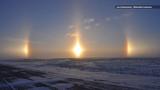 """The bright patches of light aren't lens flares! """"Sundogs"""" are a totally natural atmospheric phenomenon."""